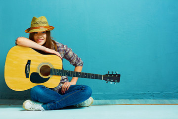 Teenager girl guitar play.