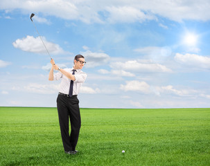 Young man playing golf on a field