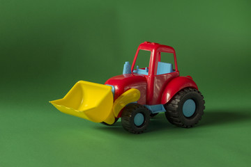 Toy tractor on green background