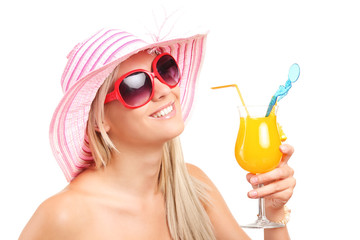 Trendy woman drinking an exotic cocktail