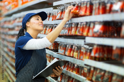 hardware store worker counting stock - 65792034