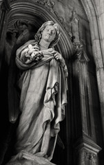 Statue of angel on entry in Saint Maurice church