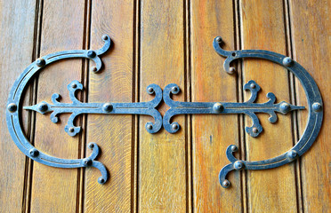 Gothic style wooden door of church in Belgium.