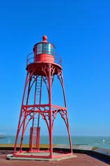 Old lighthouse on seaside of Arsenaal city