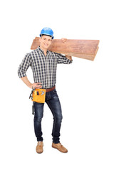 Construction worker holding a couple of planks