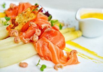 Smoked salmon with white asparagus, gray shrimps