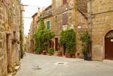 Vintage street decorated with flowers, Tuscany, Italy - 65792410
