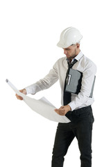 Young handsome engineer reading drawing plans