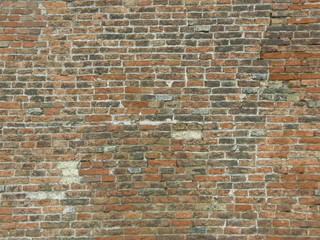 Cracked old brick wall