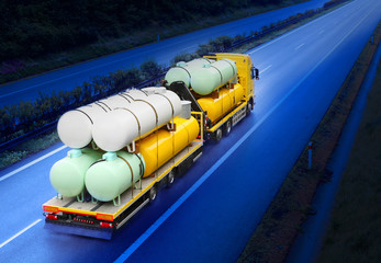The tanker truck on the highway.