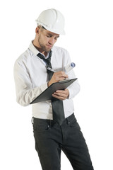 Young handsome technician writing notes on clipboard
