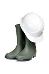 Protection helmet and rubber boots isolated with clipping path.