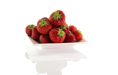plate with red strawberries
