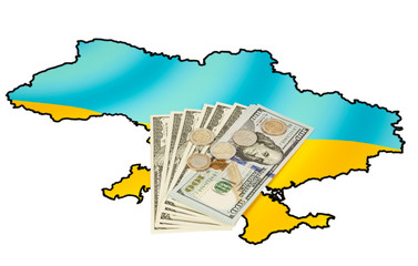 Coins and dollars on ukrainian map