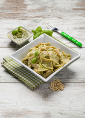 testaroli with pesto sauce, traditional italian recipe