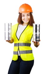 Girl in overalls and a helmet with metal cans in their hands