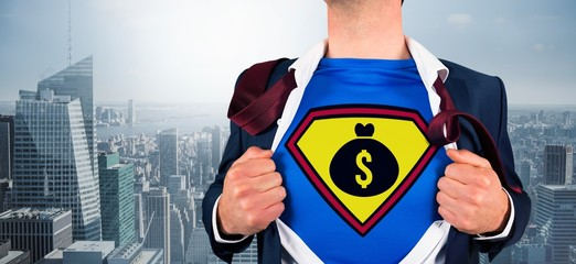 Composite image of businessman opening shirt in superhero style