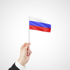 hand holding flag of Russia