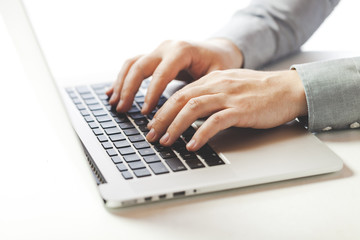 close up image of business man typing on laptop