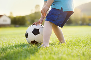 Little boy playing football
