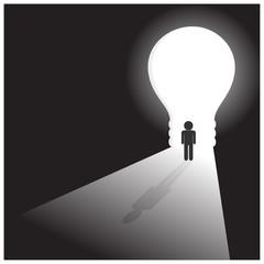 Businessman in front of a bright lightbulb door