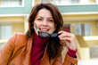 Lady in Front of House Removing Sunglasses