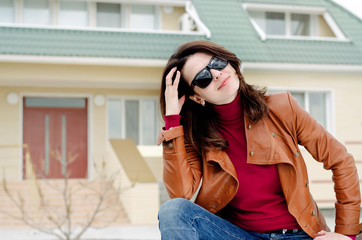 Woman in Sunglasses with Hand Behind Her Head