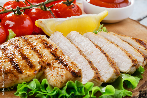Fotobehang Vlees chicken fillet grill vegetables sauce