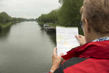 woman reading map during bike trip