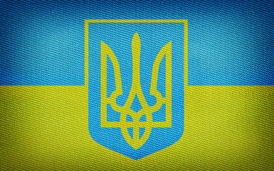 Grunge Ukrainian flag with trident on fabric backround