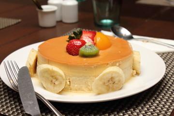 banana caramel cake on white plate