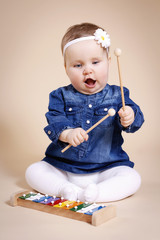 Little child playing xylophone