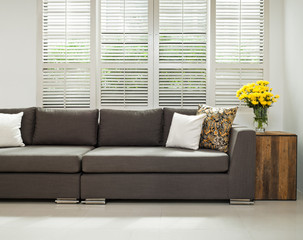 Grey sofa in simple setting