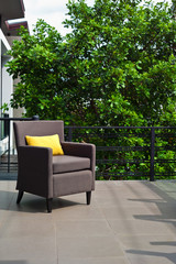 Outdoor patio seating are with nice Rattan sofa at sunset