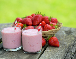 strawberry milk shake on wooden garden table