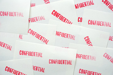 many stamped confidential on white paper