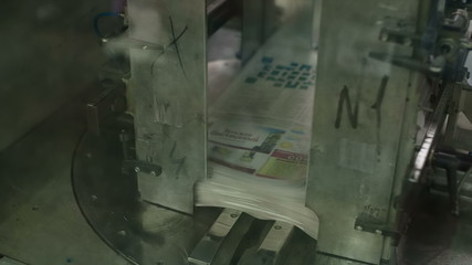 Robot packs in a large stack of newspapers