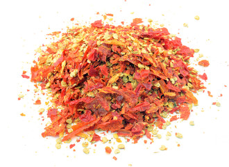 Powdered red pepper pile from top on white background