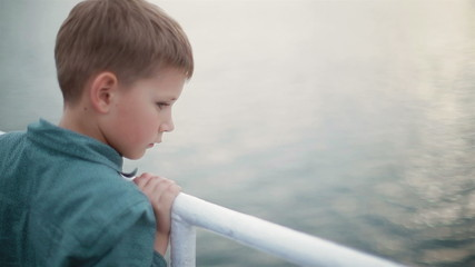 little boy dreams of standing near the water