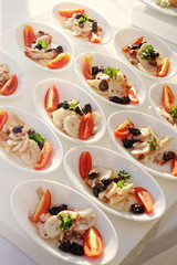 Bowls of fresh vegetable salad on a buffet table
