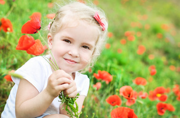 cute little girl holding a bouquet