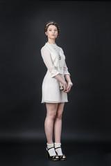Neo-Victorian model in white dress