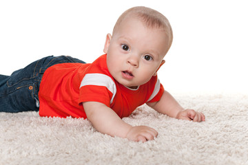 Infant boy on the carpet