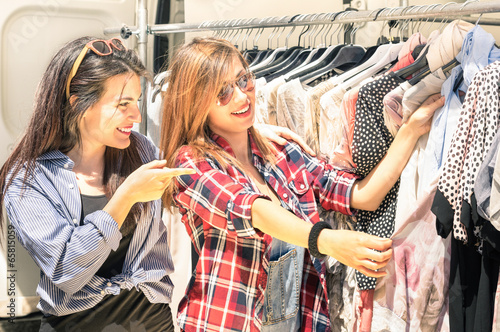 Young beautiful girlfriends at the weekly cloth market - 65815059
