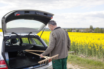 Farmer invites tools in his car