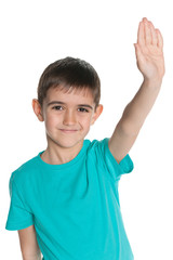 Young boy stretching his right hand up