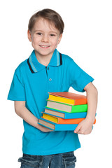 Cheerful little boy with books