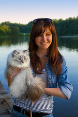 Young woman and Siberian cat
