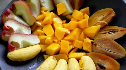 Eating Exotic Fruits from the Plate, Close up, High-Speed Camera