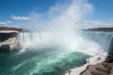 Fototapety Niagara Falls - due to a cold winter ice remain in late April